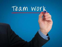 Team work concept businessman hand writing Team work - Stock image photo