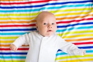 Cute baby on a colorful blanket