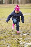 little girl splash pool photo