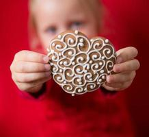 girl with heart-shaped gingerbread photo