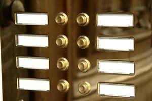 Brass buzzer doorbells for multiple occupancies photo