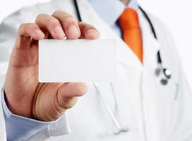 Blank business card in doctor's hand