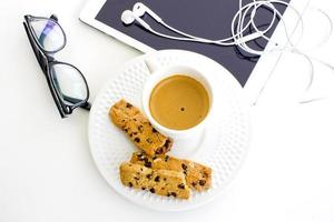 modern business background. Computer tablet with eyeglasses and white coffee