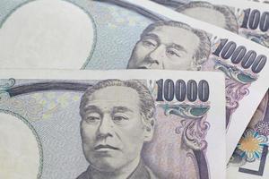primer plano de billetes de yen japonés por concepto de finanzas foto