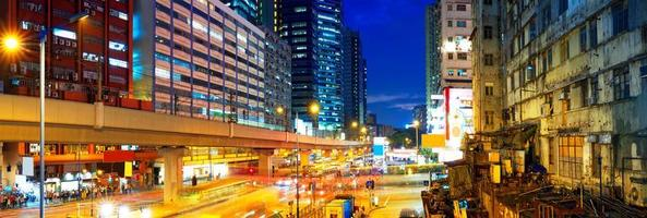 busy highway train traffic night in finance urban photo