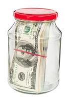 Pack of dollars in a glass jar