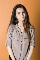Beautiful young girl in the studio photo