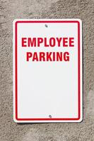 Employee Parking Sign on Wall