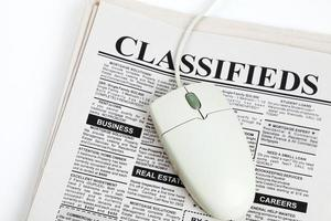 Classified Ad and computer mouse photo