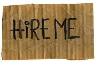hire me - cardboard sign photo