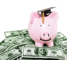 smiling piggy bank with graduation cap photo