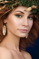 Portrait of beautiful redhaired woman with firry wreath