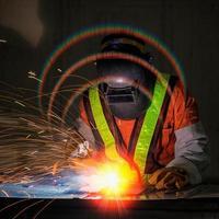 Worker welding photo