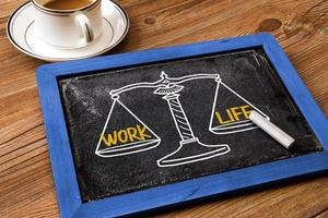 work life concept on balance scale photo