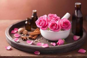spa and aromatherapy set with rose flowers mortar, spices