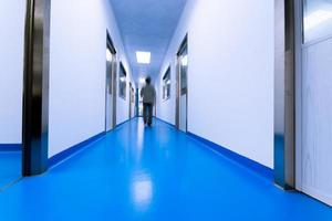 people walking in modern laboratory