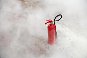 Fire Extinguisher with smoke background photo