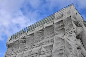 Building site covered in gray tarpaulin