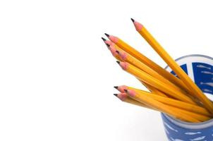 Blue cup of sharpened pencils on white background photo