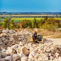 Excavator in quarry photo