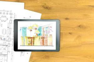 lugar de trabajo de arquitecto con tableta digital y planos foto