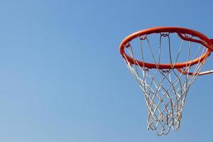 Basketball hoop against blue skies photo