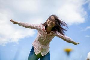 girl with arms outstretched