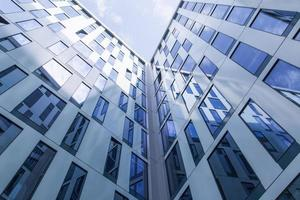 Abstract facade lines and glass reflection on modern building photo