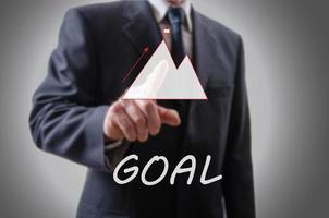 Businessman indicating the goal photo