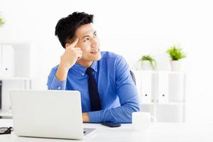 Young asian businessman planning and thinking photo