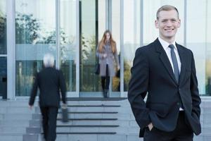 Businessman standing in front of office