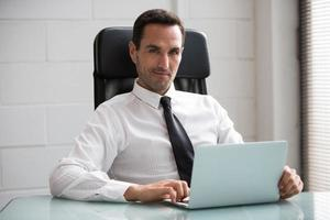 businessman in the office with laptop computer photo