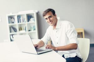 Young man in the office photo