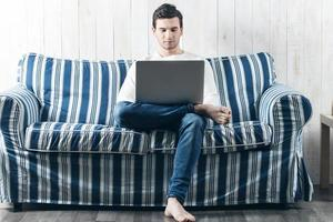 man working at a laptop photo