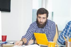 Modern businessman working in office photo