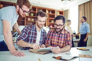 Businessmen computing photo