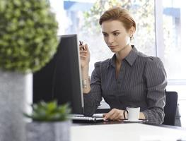 Attractive businesswoman working with computer