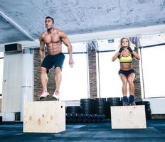 Group of man and woman working out with fit box photo