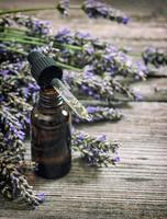 Perfumed herbal oil essence and lavender flowers vintage photo
