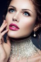 Beautiful woman. Bride. Gems.