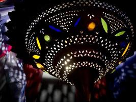 Moroccan style lamp with glass inset, exotic, mysterious and beautiful photo