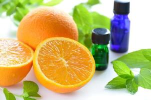 essential oils with orange and herbs photo