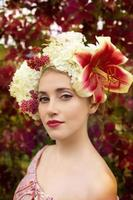 beautiful woman portrait with natural flowers hairstyle