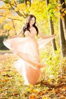 Attractive woman. Autumn, fall yellow leafs.