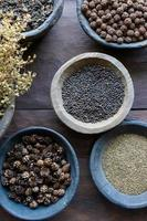 Herbs and spices in bowls photo