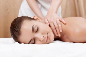 Masseur gives neck and shoulder massage