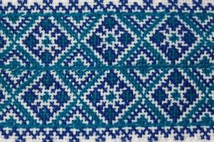 Close up of homemade blue Ukrainian Embroidery shirt piece