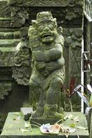 Protection guard made of stone in bali photo