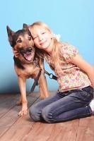 Cute little girl holding dog photo