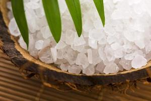 sea salt with palm leaf photo